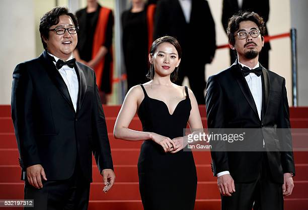 Actor Kwak Dowon actress Chun WooHee and director Na HongJin attend The Strangers Premiere during the 69th annual Cannes Film Festival at the Palais...