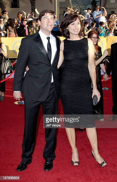 Actor Kyle Chandler and Kathryn Chandler arrive at the 18th Annual Screen Actors Guild Awards held at The Shrine Auditorium on January 29, 2012 in...