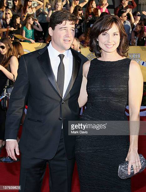 Actor Kyle Chandler and Kathryn Chandler arrive at The 18th Annual Screen Actors Guild Awards broadcast on TNT/TBS at The Shrine Auditorium on...