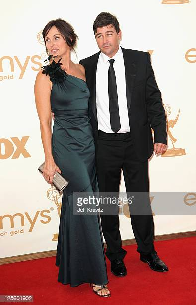 Actor Kyle Chandler and Kathryn Chandler arrive at the 63rd Primetime Emmy Awards at Nokia Theatre L.A. Live on September 18, 2011 in Los Angeles,...
