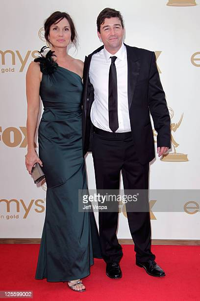 Actor Kyle Chandler and Kathryn Chandler arrive to the 63rd Primetime Emmy Awards at the Nokia Theatre LA Live on September 18 2011 in Los Angeles...