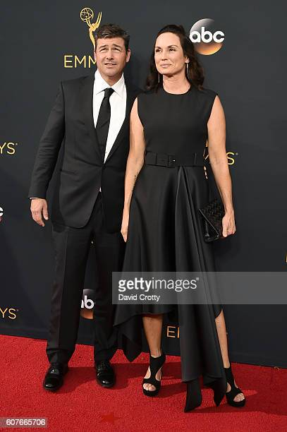 Actor Kyle Chandler and Kathryn Chandler attends the 68th Annual Primetime Emmy Awards at Microsoft Theater on September 18 2016 in Los Angeles...