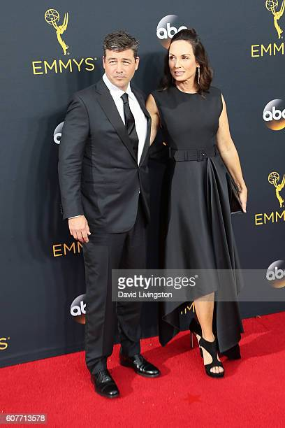 Actor Kyle Chandler and screenwriter Kathryn Chandler arrive at the 68th Annual Primetime Emmy Awards at the Microsoft Theater on September 18, 2016...