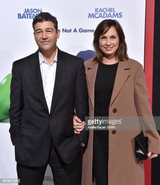 Actor Kyle Chandler and screenwriter Kathryn Chandler arrive at the Los Angeles premiere of 'Game Night' at TCL Chinese Theatre on February 21, 2018...