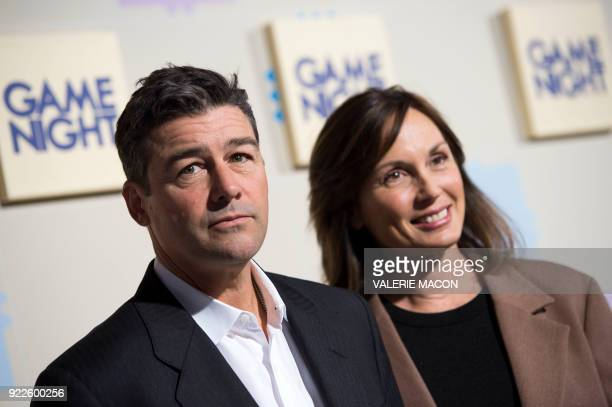 Actor Kyle Chandler and wife Kathryn Chandler arrive for the World Premiere of Warner Bros Game Night on February 21 in Hollywood California / AFP...