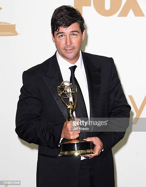Actor Kyle Chandler poses in the press room during the 63rd Primetime Emmy Awards at Nokia Theatre L.A. Live on September 18, 2011 in Los Angeles,...