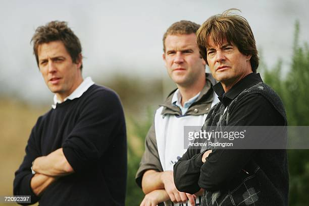 Actor Kyle MacLachlan waits alongside actor Hugh Grant before teeing off on the 11th Hole during the First Round of The Alfred Dunhill Links...