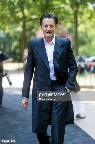 Actor Kyle MacLachlan wearing black coat black pants and white button shirt outside Balenciaga during Paris Fashion Week Menswear Spring/Summer 2018...