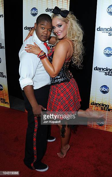 Actor Kyle Massey and dance partner Lacey Schwimmer pose at 'Dancing With The Stars' Season Premiere at CBS Studios on September 20 2010 in Los...