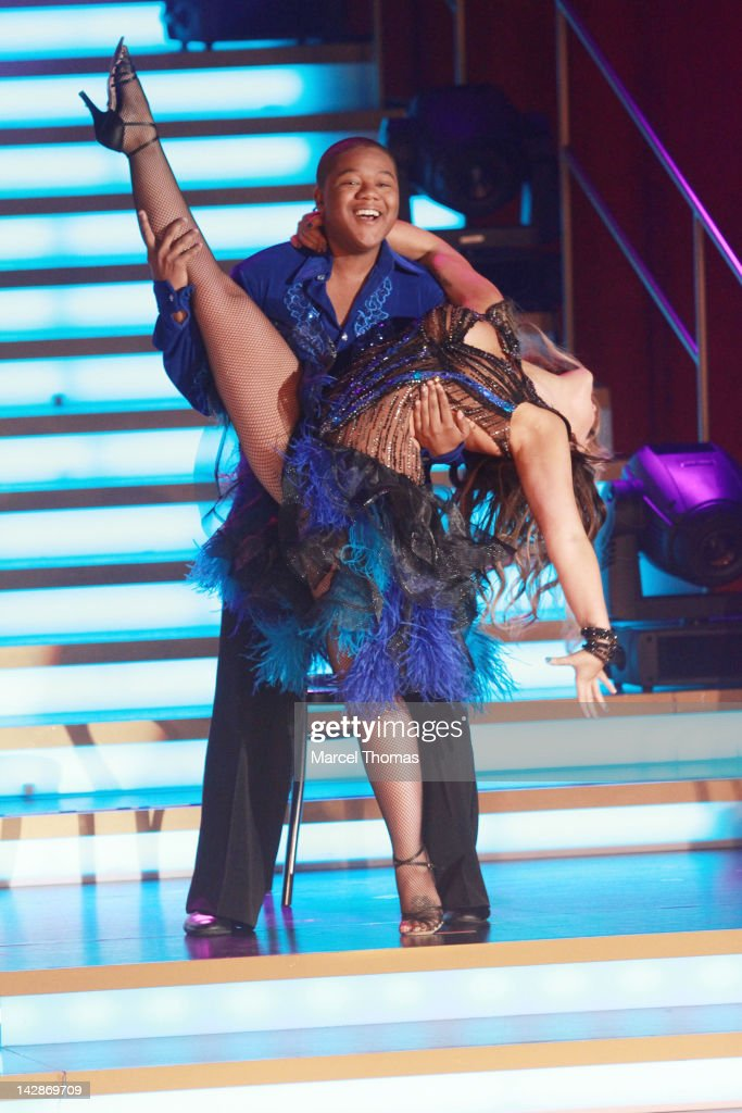 Actor Kyle Massey and dancer Lacey Schwimmer perform on stage as part of 'Dancing With The Stars: Live In Las Vegas' at The Tropicana on April 13, 2012 in Las Vegas, Nevada.