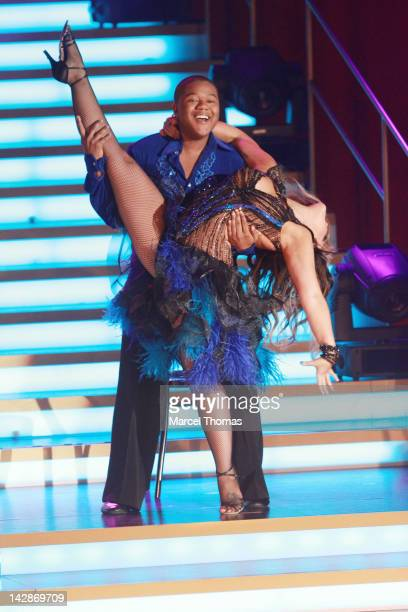 Actor Kyle Massey and dancer Lacey Schwimmer perform on stage as part of Dancing With The Stars Live In Las Vegas at The Tropicana on April 13 2012...