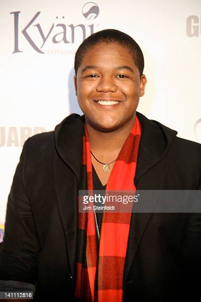 Actor Kyle Massey poses on the red carpet at The Guard A Heart tribute to Larry King at the Avalon Ballroom in Hollywood California on February 25...