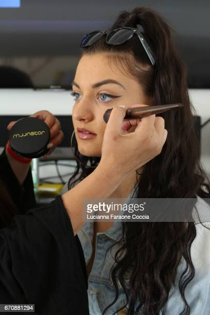 Actor Laci Kay getting makeup done by makeup artist Jade Martinez with Moonstar Beauty products at a day of IMPRESSIONS with brands and influencers...
