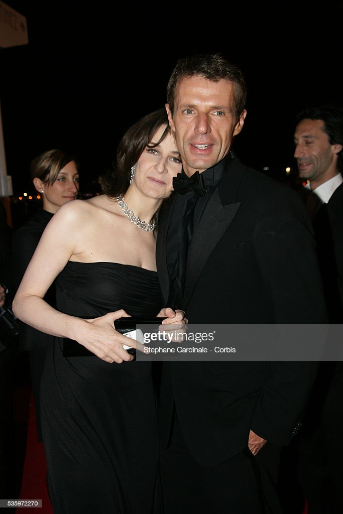 Actor Lambert Wilson and actress Valerie Lemercier attend the closing ceremony dinner during the 58th Cannes Film Festival.