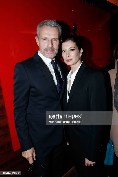 Actor Lambert Wilson and Dancer Marie-Agnes Gillot attend the Berluti Cocktail as part of the Paris Fashion Week Womenswear Spring/Summer 2019 on...