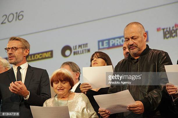 Actor Lambert Wilson Director Agnes Varda Actress Monica Bellucci and Director JeanPierre Jeunet sing during Lumiere Film Festival's opening ceremony...