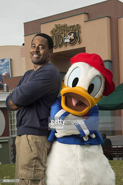 Actor Lamman Rucker poses with Donald Duck during the Disney Dreamers Academy weekend at Walt Disney World Resort on March 06 2015 in Lake Buena...