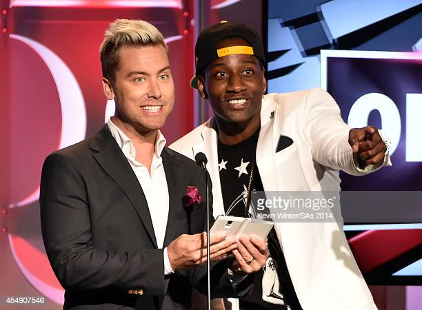 Actor Lance Bass and DeStorm speak onstage during the 4th Annual Streamy Awards presented by CocaCola on September 7 2014 in Beverly Hills California