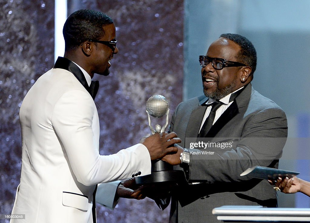 Actor Lance Gross (L) accepts Outstanding Supporting Actor in a Comedy Series for 'Tyler Perry's House of Payne' from actor Cedric the Entertainer onstage during the 44th NAACP Image Awards at The Shrine Auditorium on February 1, 2013 in Los Angeles, California.