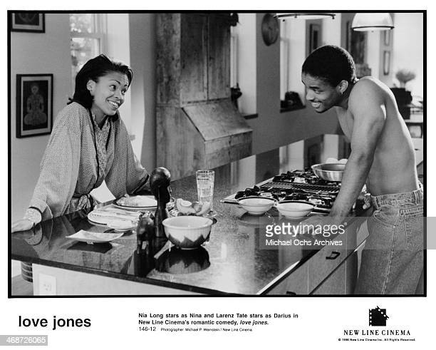 Actor Larenz Tate and actress Nia Long on set of the New Line Cinema movie ' Love Jones' circa 1997