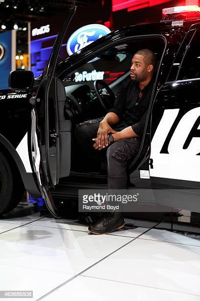 Actor Laroyce Hawkins on NBC's 'Chicago PD' films a commercial in the 2015 Ford Police Interceptor at the 107th Annual Chicago Auto Show at McCormick...
