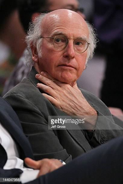 Actor Larry David watches as he sits courtside for Game Five of the Western Conference Quarterfinals in the 2012 NBA Playoffs between the Los Angeles...