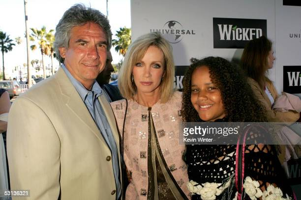 """Actor Larry Gilman, actress Donna Mills and daughter Chloe arrive at the Los Angeles Premiere of the Broadway musical """"Wicked"""" at the Pantages..."""