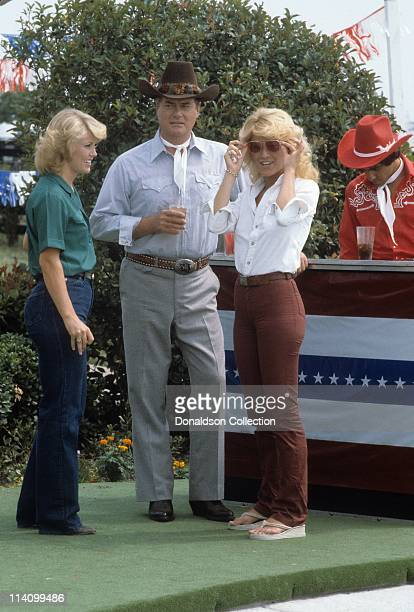 Actor Larry Hagman on set of Dallas, with extras, in July 18, 1979 in Los Angeles, California.