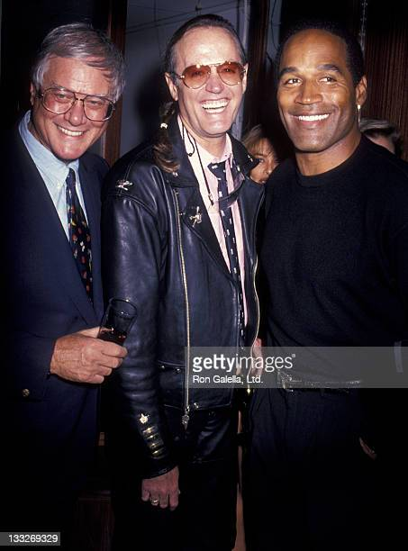 Actor Larry Hagman Peter Fonda and OJ Simpson attend the opening of Harley Davidson Cafe on October 19 1993 in New York City