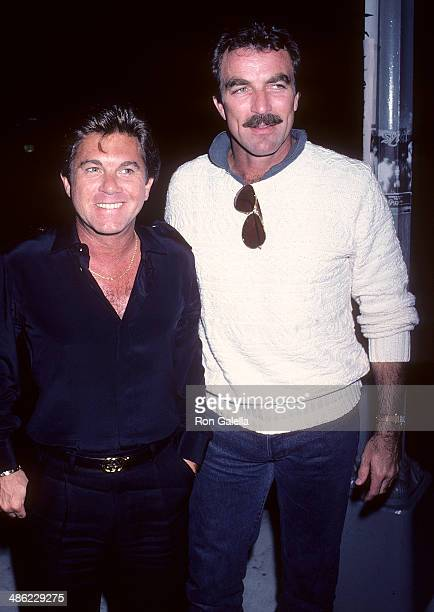 Actor Larry Manetti and actor Tom Selleck on June 2 1986 dine at Nicky Blair's Restaurant in West Hollywood California