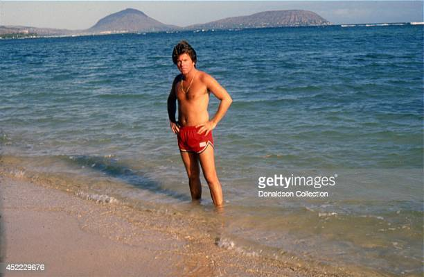 Actor Larry Manetti poses for a portrait session in the ocean in front of Diamond Head in circa 1982 in Hawaii