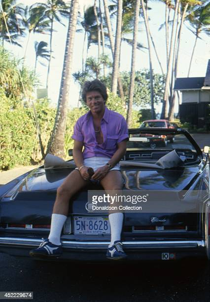 Actor Larry Manetti poses for a portrait session on a Cadillac Eldorado in circa 1982 in Hawaii