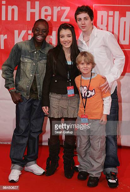 Actor Lathaniel Dyer actress Alice Connor actor Jasper Harris and actor Aaron Johnson attend the after party at the Ein Herz fuer Kinder television...
