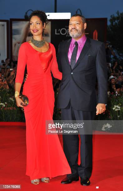 Actor Laurence Fishburne and Gina Torres attends the Contagion premiere during the 68th Venice Film Festival at Palazzo del Cinema on September 3...