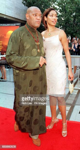 Actor Laurence Fishburne and his fiance actress Gina Torres from the TV show Cleopatra 2525 arrive for the film premiere of 'Apocalypse Now Redux' at...