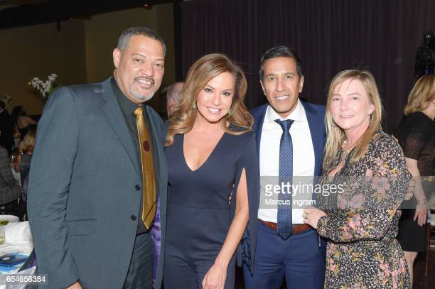 Actor Laurence Fishburne Robin Meade Sanjay Gupta and Rebecca Gupta attend UNICEF's Evening For Children First at The Foundry At Puritan Mill on...