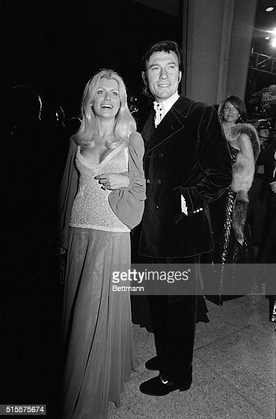 Actor Laurence Harvey and his wife the former Pauline Stone shown as they arrived at the Music Center to attend the 458th annual Academy Awards