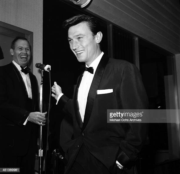 Actor Laurence Harvey attends a party in Los Angeles California