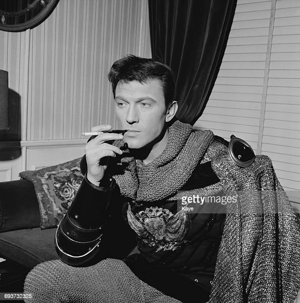 Actor Laurence Harvey in his dressing room whilst appearing as King Arthur in the musical 'Camelot' on Drury Lane London 7th February 1965