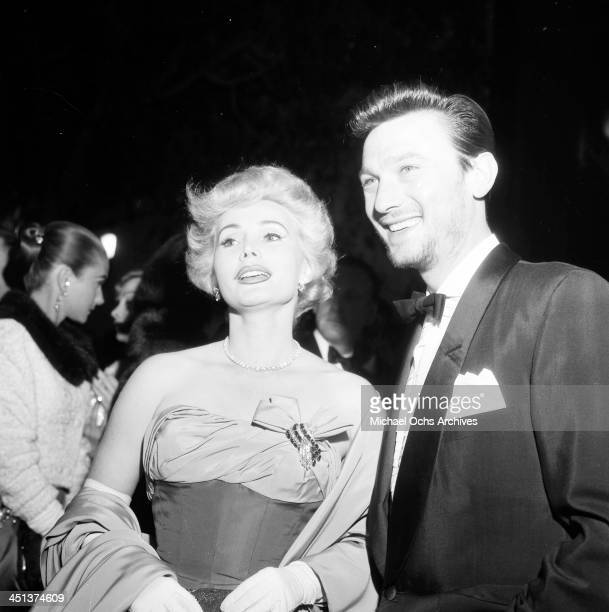 Actor Laurence Harvey with guest attend a party in Los Angeles California