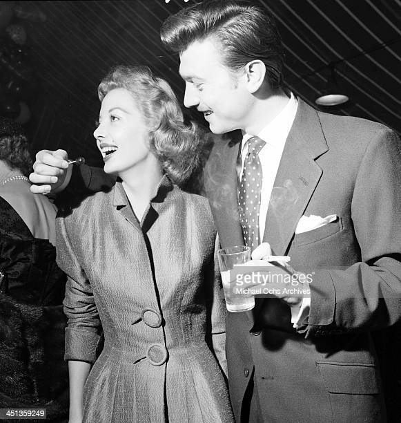 Actor Laurence Harvey with Norma Brooks attend a Mike Todd party in Los Angeles, California.