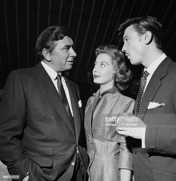 Actor Laurence Harvey with Robert Newton and Norma Brooks attend a Mike Todd party in Los Angeles California