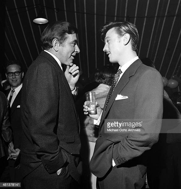Actor Laurence Harvey with Robert Newton attend a Mike Todd party in Los Angeles California