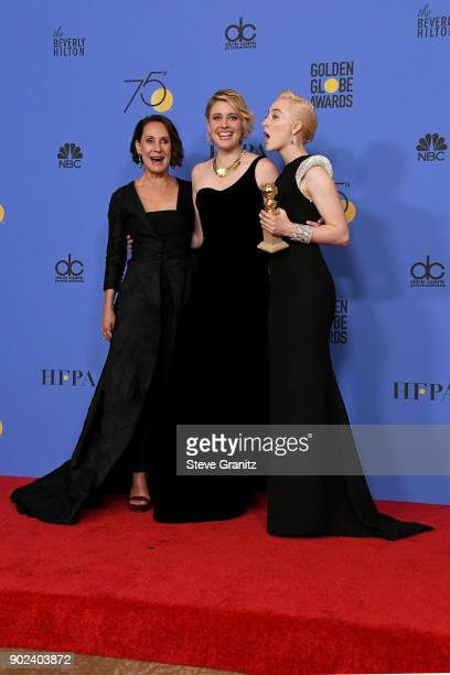 Actor Laurie Metcalf actor/director Greta Gerwig and actor Saoirse Ronan pose with the award for Best Motion Picture for 'Lady Bird' poses in the...