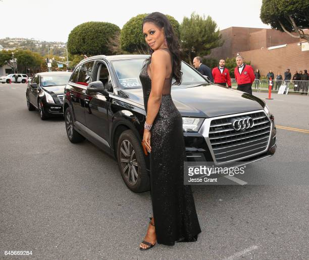 Actor Laverne Cox arrives in an Audi Q7 to the 25th Annual Elton John AIDS Foundation's Academy Awards Viewing Party at The City of West Hollywood...