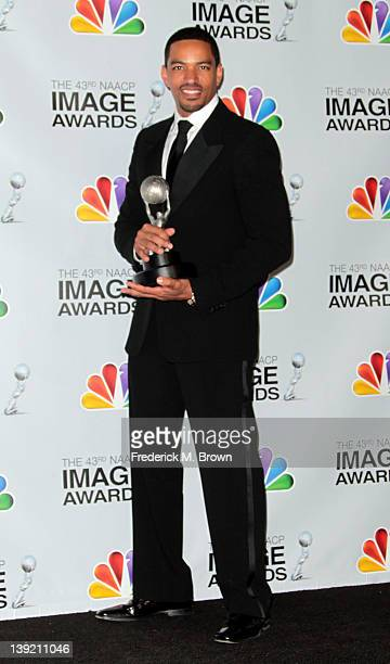 Actor Laz Alonzo poses with the award for Outstanding Actor in a Motion Picture for 'Jumping the Broom' in the press room at the 43rd NAACP Image...