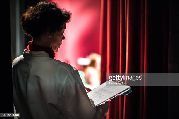 actor learning his lines backstage - attrice foto e immagini stock