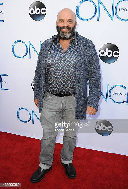 """Actor Lee Arenberg attends ABC's """"Once Upon A Time"""" Season 4 red carpet premiere at the El Capitan Theatre on September 21, 2014 in Hollywood,..."""