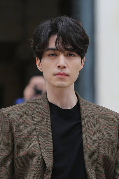 Actor Lee Dong Wook attends the Givenchy show as part of the Paris Fashion Week Womenswear Spring/Summer 2018 on October 1 2017 in Paris France
