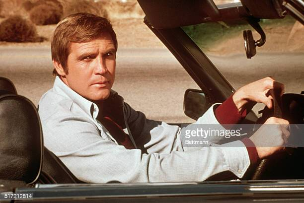 Actor Lee Majors riding in an automobile during a scene from his television show, The Six Million Dollar Man.